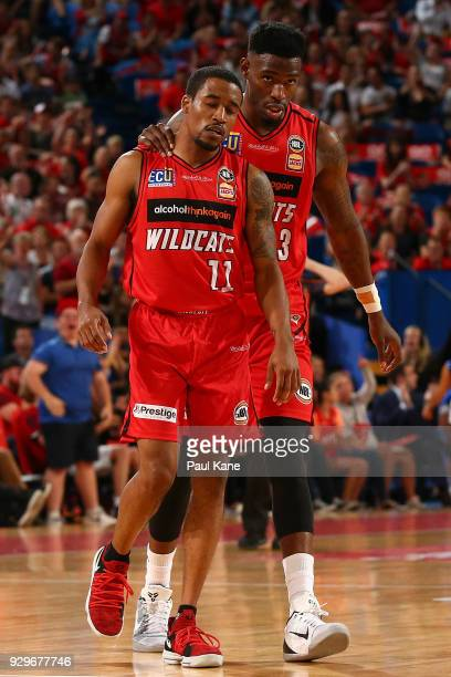 Bryce Cotton and Derek Cooke Jr of the Wildcats walk to the bench during game two of the NBL Semi Final series between the Adelaide 36ers and the...