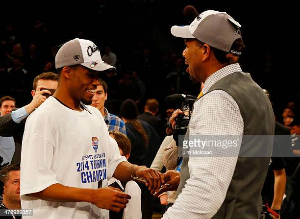 Bryce Cotton and head coach Ed Cooley of the Providence Friars celebrate their 65 to 58 win over the Creighton Bluejays during the Championship game...