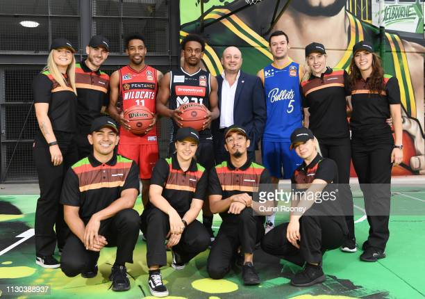 Bryce Cotton of the Perth Widcats, Casper Ware of Melbourne United, Larry Kestelman and Jason Cadee of the Brisbane Bullets pose with theHungry Jacks...