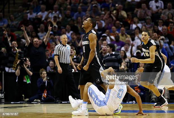 Bryce Cotton of the Providence Friars celebrates after hitting a three pointer against the North Carolina Tar Heels during the second half of the...