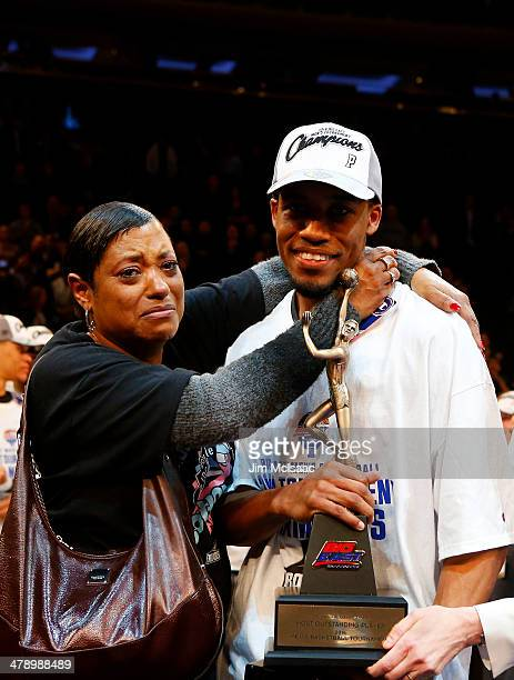 Bryce Cotton of the Providence Friars celebrates with his mother after their 65 to 58 win over the Creighton Bluejays in the Championship game of the...