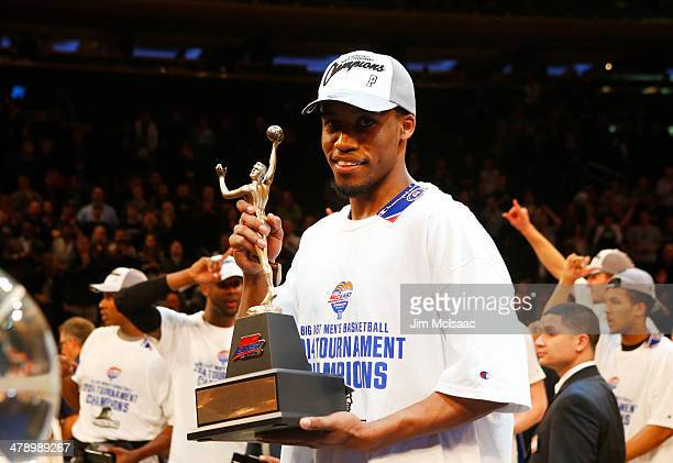 Bryce Cotton of the Providence Friars celebrates with the most outstanding player award after their 65 to 58 win over the Creighton Bluejays in the...