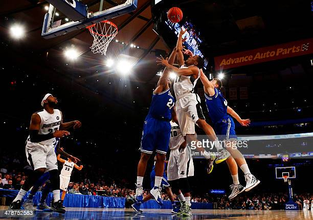 Bryce Cotton of the Providence Friars shoots against Patrik Auda and Eugene Teague of the Seton Hall Pirates in the second half during the Semifinals...