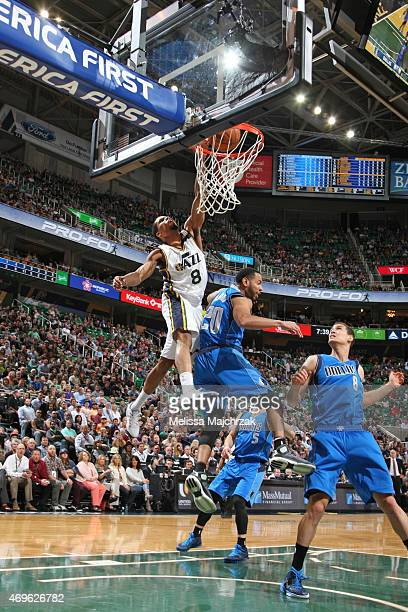 Bryce Cotton of the Utah Jazz goes up for a dunk against the Dallas Mavericks on April 13 2015 at EnergySolutions Arena in Salt Lake City Utah NOTE...