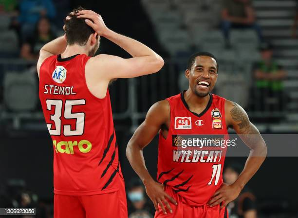 Bryce Cotton of the Wildcats and Clint Steindl of the Wildcats look on after the win during the NBL Cup match between the Perth Wildcats and the New...