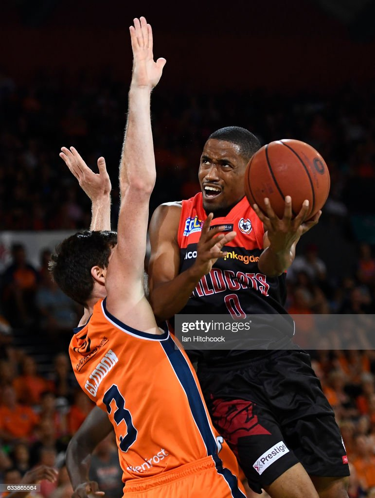 Bryce Cotton of the Wildcats attempts a lay up over Cam Gliddon of the Taipans during the round 18 NBL match between the Cairns Taipans and the Perth Wildcats at the Cairns Convention Centre on February 5, 2017 in Cairns, Australia.