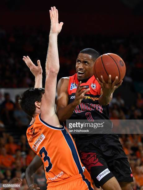 Bryce Cotton of the Wildcats attempts a lay up over Cam Gliddon of the Taipans during the round 18 NBL match between the Cairns Taipans and the Perth...