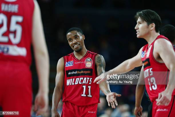 Bryce Cotton of the Wildcats can only smile with a foul called against him during the round six NBL match between the New Zealand Breakers and the...