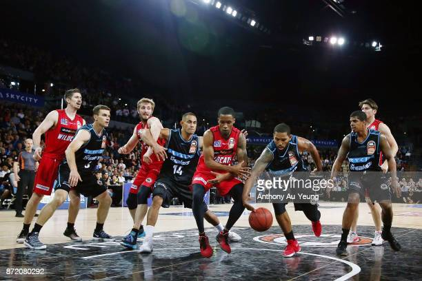 Bryce Cotton of the Wildcats competes for a loose ball against Devonte DJ Newbill of the Breakers during the round six NBL match between the New...