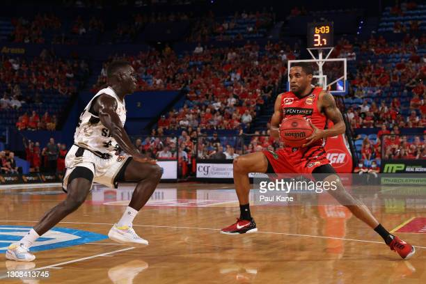 Bryce Cotton of the Wildcats controls the ball against Sunday Dech of the 36ers during the round 10 NBL match between the Perth Wildcats and the...