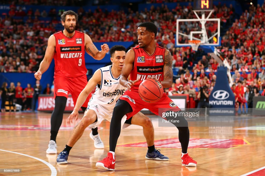 Bryce Cotton of the Wildcats controls the ball against Travis Trice of the Bullets during the round one NBL match between the Perth Wildcats and the Brisbane Bullets at Perth Arena on October 7, 2017 in Perth, Australia.