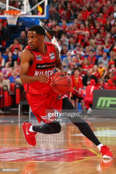 Bryce Cotton of the Wildcats controls the ball during the round one NBL match between the Perth Wildcats and the Brisbane Bullets at Perth Arena on...
