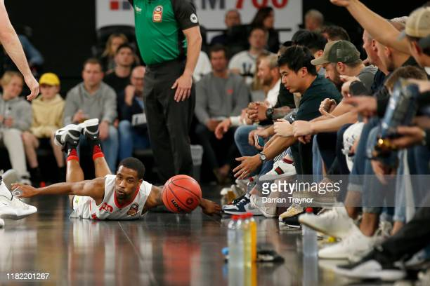 Bryce Cotton of the Wildcats dives for the ball during the round three NBL match between Melbourne United and the Perth Wildcats at Melbourne Arena...