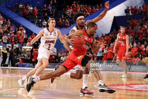 Bryce Cotton of the Wildcats drives to the basket against Justin Simon of the Hawks during the round 14 NBL match between the Perth Wildcats and the...