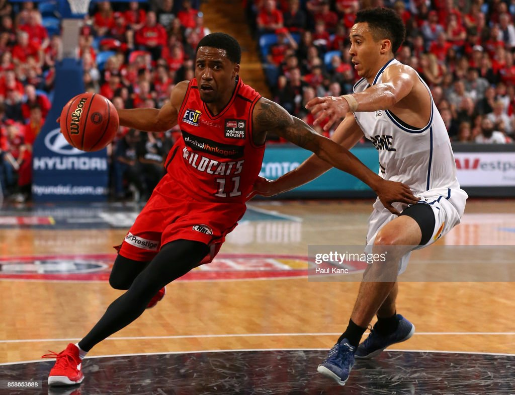 Bryce Cotton of the Wildcats drives to the basket against Travis Trice of the Bullets during the round one NBL match between the Perth Wildcats and the Brisbane Bullets at Perth Arena on October 7, 2017 in Perth, Australia.