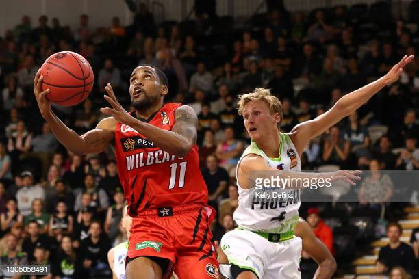 Bryce Cotton of the Wildcats drives to the basket late in the fourth quarter during the NBL Cup match between the Perth Wildcats and the South East...