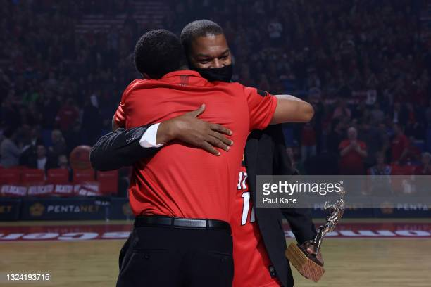 Bryce Cotton of the Wildcats embraces former Wildcats champion Rick Grace before being presented his 2021 NBL MVP trophy during game one of the NBL...