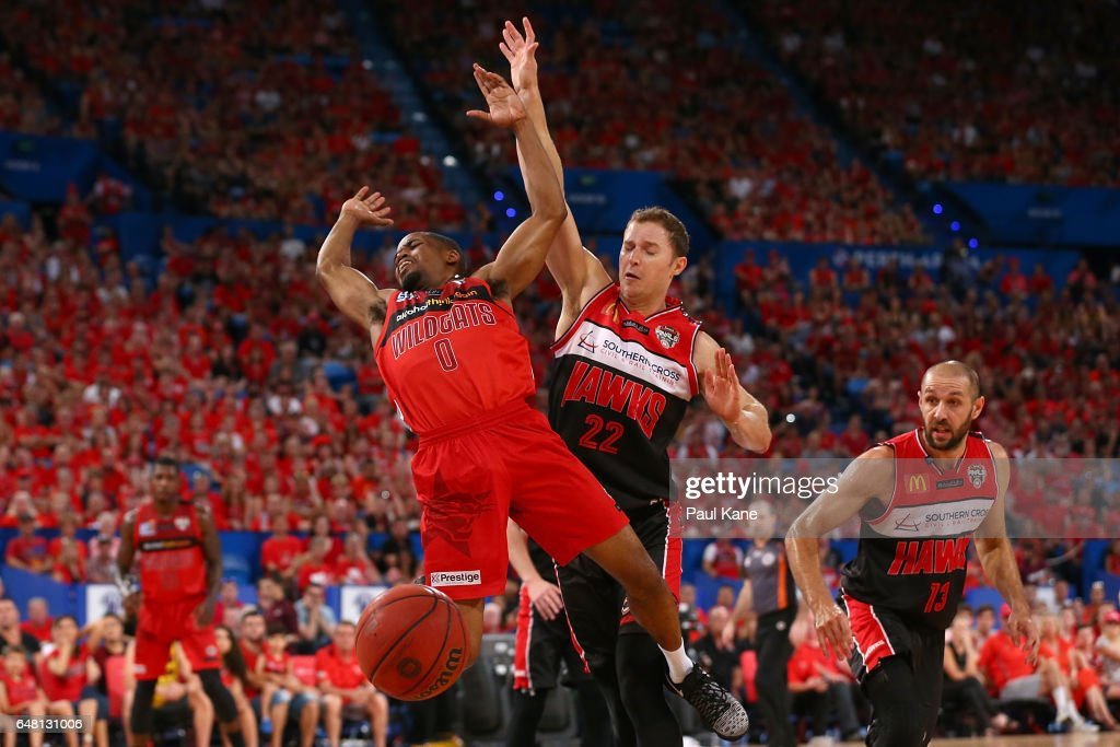 Bryce Cotton of the Wildcats gets fouled by Tim Coenraad of the Hawks during game three of the NBL Grand Final series between the Perth Wildcats and the Illawarra Hawks at Perth Arena on March 5, 2017 in Perth, Australia.