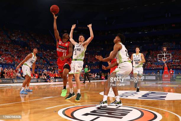 Bryce Cotton of the Wildcats goes to the basket against Cameron Gliddon of the Phoenix during the round three NBL match between the Perth Wildcats...