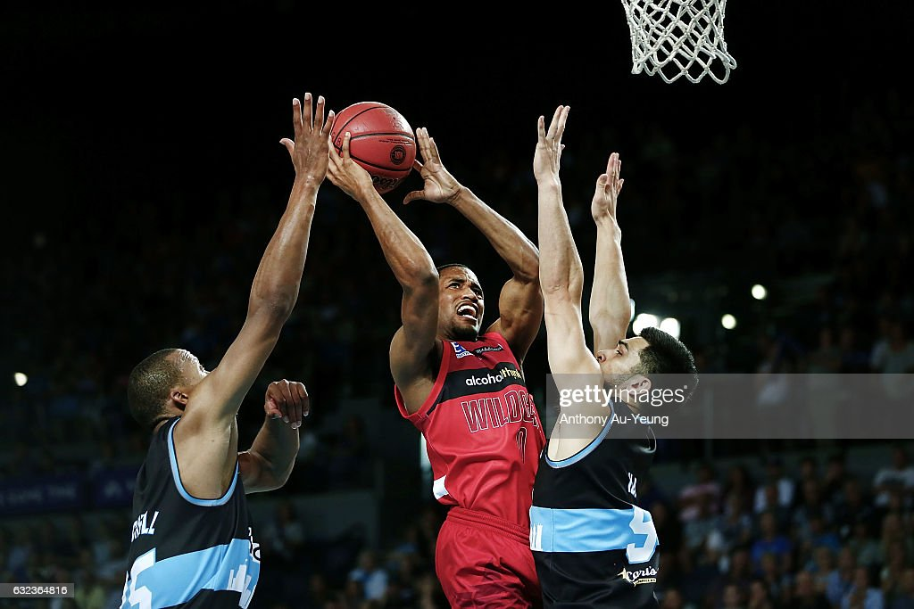 Bryce Cotton of the Wildcats goes up against Shea Ili and Akil Mitchell of the Breakers during the round 16 NBL match between the New Zealand Breakers and the Perth Wildcats at Vector Arena on January 22, 2017 in Auckland, New Zealand.