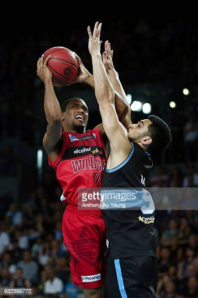 Bryce Cotton of the Wildcats goes up against Shea Ili of the Breakers during the round 16 NBL match between the New Zealand Breakers and the Perth...