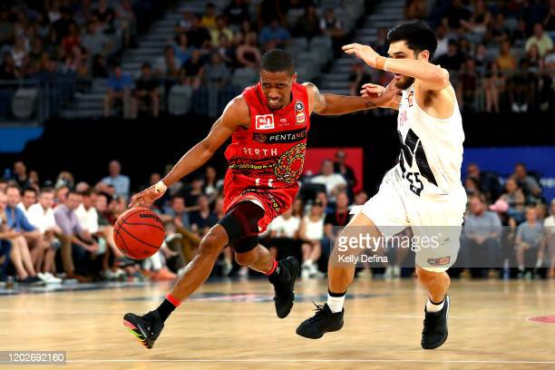 Bryce Cotton of the Wildcats handles the ball under pressure from Shea Ili of United during the round 18 NBL match between Melbourne United and the...