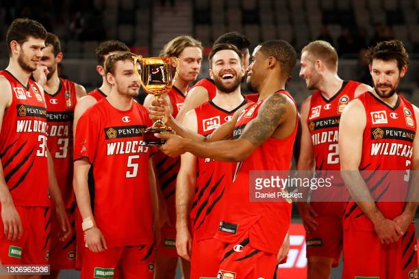 Bryce Cotton of the Wildcats holds the NBL Cup trophy after their match between the Perth Wildcats and the Adelaide 36ers at John Cain Arena on March...