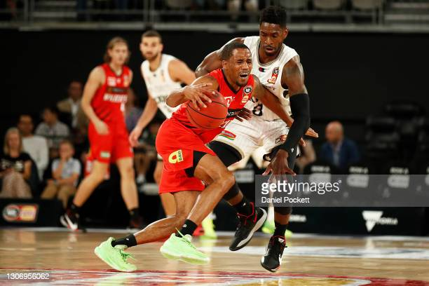 Bryce Cotton of the Wildcats is fouled by Brandan Paul of the 36ers during the NBL Cup match between the Perth Wildcats and the Adelaide 36ers at...