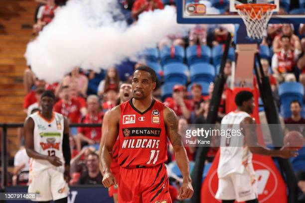 Bryce Cotton of the Wildcats looks on after shooting a three during the NBL match between the Perth Wildcats and the Cairns Taipans at RAC Arena on...