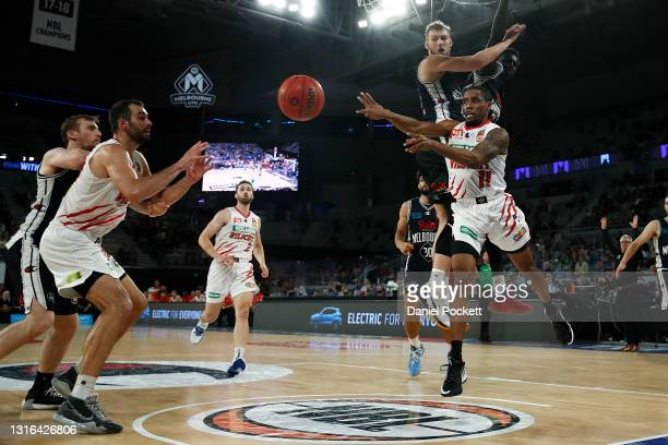 Bryce Cotton of the Wildcats passes the ball under the basket during the round 16 NBL match between Melbourne United and the Perth Wildcats at John...