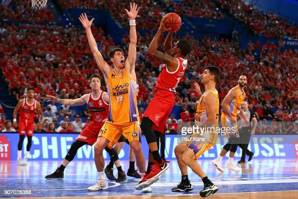 Bryce Cotton of the Wildcats puts a shot up against Dane Pineau of the Kings during the round 15 NBL match between the Perth Wildcats and the Sydney...