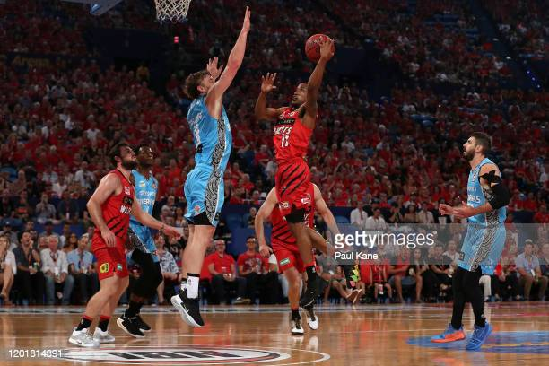 Bryce Cotton of the Wildcats puts a shot up against Finn Delany of the Breakers during the round 17 NBL match between the Perth Wildcats and the New...