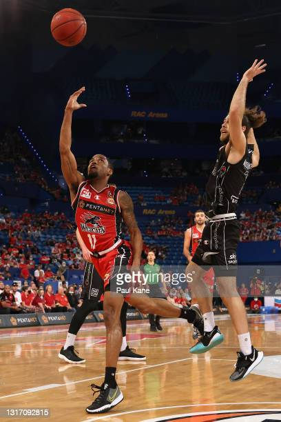 Bryce Cotton of the Wildcats puts a shot up against William McDowell-White of the Breakers during the round 17 NBL match between Perth Wildcats and...
