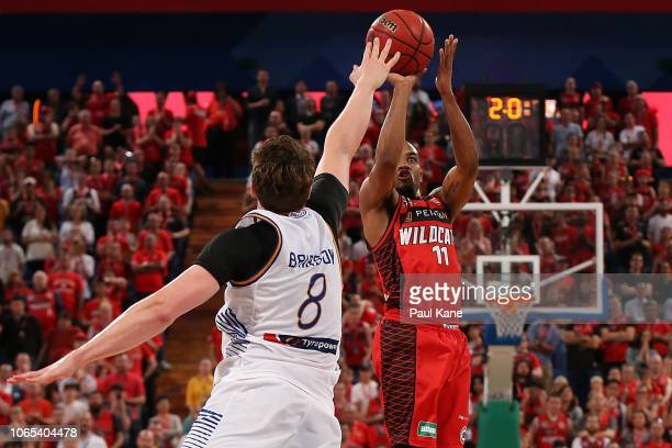 Bryce Cotton of the Wildcats puts up a shot to win the game during the round five NBL match between the Perth Wildcats and the Brisbane Bullets at...