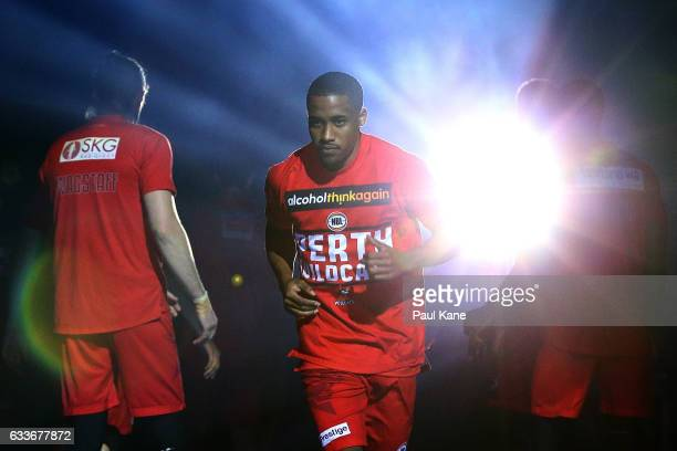 Bryce Cotton of the Wildcats runs onto the court as players are introduced during the round 18 NBL match between the Perth Wildcats and the Brisbane...