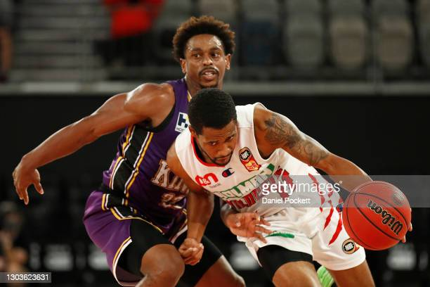 Bryce Cotton of the Wildcats runs with the ball under pressure from Casper Ware of the Kings during the NBL Cup match between the Sydney Kings and...
