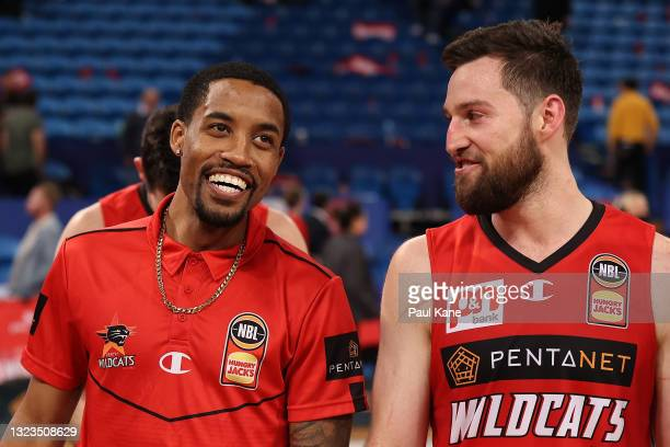 Bryce Cotton of the Wildcats shares a moment with Mitchell Norton after winning game three of the NBL Semi-Final Series between the Perth Wildcats...