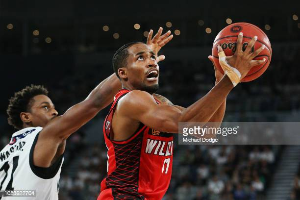 Bryce Cotton of the Wildcats shoots past Casper Ware of United during the round nine NBL match between the Melbourne United and the Perth Wildcats at...