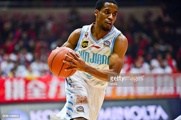 Bryce Cotton of Xinjiang Flying Tigers drives the ball during the 37th round of the Chinese Basketball Association 15/16 game between Xinjiang Flying...