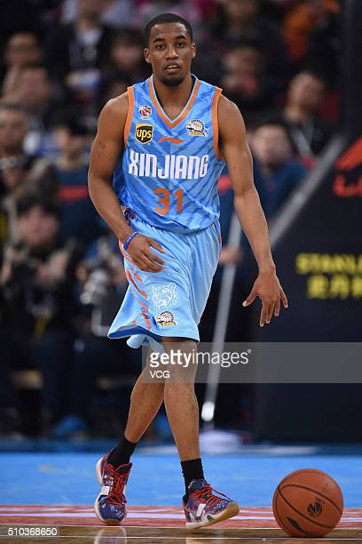 Bryce Cotton of Xinjiang Flying Tigers drives the ball during the Chinese Basketball Association 15/16 season playoff quarterfinal match between...