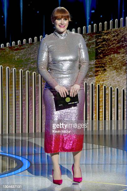 Bryce Dallas Howard presents the award for Best Director Motion Picture onstage during the 78th Annual Golden Globe® Awards at The Rainbow Room on...