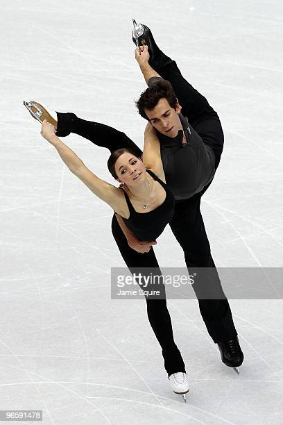 Bryce Davison and Jessica Dube of Canada compete in the figure skating pairs short program practice held at Pacific Coliseum ahead of the Vancouver...