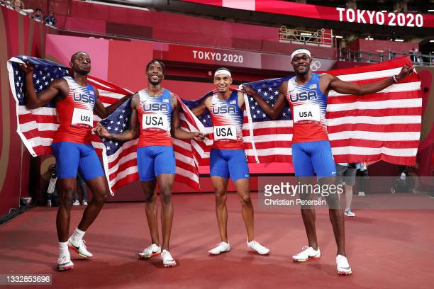 Bryce Deadmon, Michael Cherry, Michael Norman and Rai Benjamin of Team United States celebrate after winning the gold medal in the Men's 4 x 400m...
