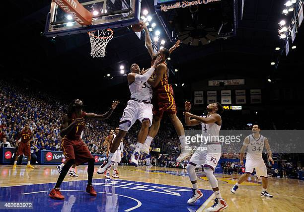 Bryce DejeanJones of the Iowa State Cyclones goes up for a dunk but is fouled by Landen Lucas of the Kansas Jayhawks in the second half at Allen...