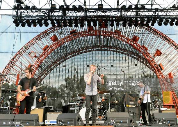 Bryce Dessner Matt Berninger and Scott Devendorf of The National perform onstage during Bonnaroo 2010 at Which Stage on June 11 2010 in Manchester...