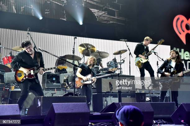 Bryce Dessner of The National and Marcus Mumford Winston Marshall and Ted Dwane of Mumford Sons perform onstage during iHeartRadio ALTer Ego 2018 at...