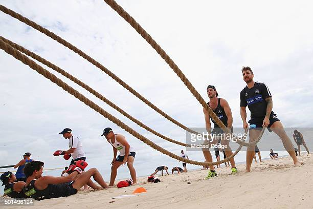 Bryce Gibbs and Zach Tuohy lift ropes up and down during a circuit training session at Kurrawa Beach during the Carlton Blues AFL preseason training...