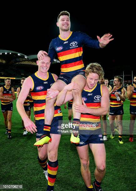 Bryce Gibbs of the Adelaide Crows is carried off by Sam Jacobs and Rory Sloane of the Adelaide Crows during the round 20 AFL match between the...