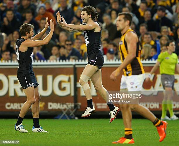 Bryce Gibbs of the Blues celebrates a goal with Dale Thomas of the Blues during the round 13 AFL match between the Carlton Blues and the Hawthorn...