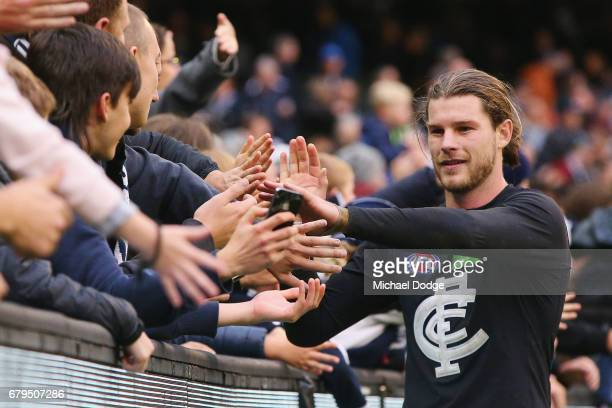 Bryce Gibbs of the Blues celebrates the win with fans during the round seven AFL match between the Collingwood Magpies and the Carlton Blues at...